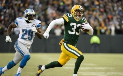 Dec 28, 2014; Green Bay, WI, USA; Green Bay Packers safety Micah  Hyde (33) returns a punt 55-yards for a touchdown in the first quarter during the game against the Detroit Lions at Lambeau Field. At left is Detroit Lions cornerback <a rel=