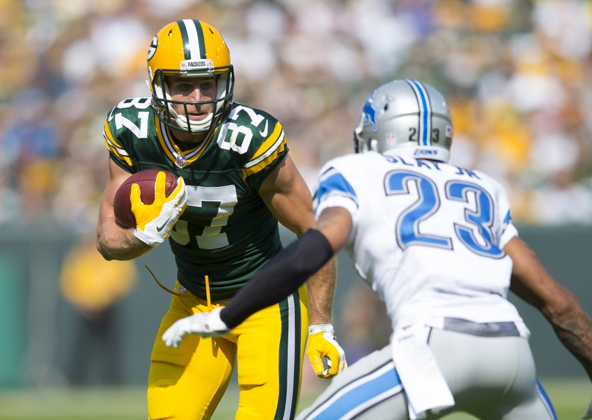 Green Bay Packers wide receiver Jordy Nelson rushes with the football after catching a pass as Detroit Lions cornerback Darius Slay defends during the second quarter at Lambeau Field. Jeff Hanisch-USA TODAY Sports