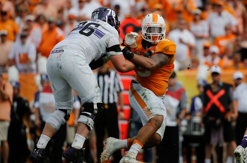 Tennessee Volunteers defensive end Derek Barnett (9) rushes past Northwestern Wildcats offensive lineman Eric Olson (76) during the first half in the 2016 Outback Bowl at Raymond James Stadium. Kim Klement-USA TODAY Sports