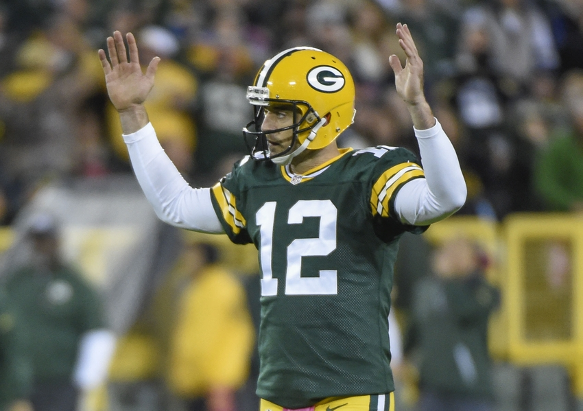 Green Bay Packers quarterback Aaron Rodgers reacts after throwing a touchdown pass to wide receiver Davante Adams (not pictured) in the second quarter during the game against the New York Giants at Lambeau Field. Benny Sieu-USA TODAY Sports