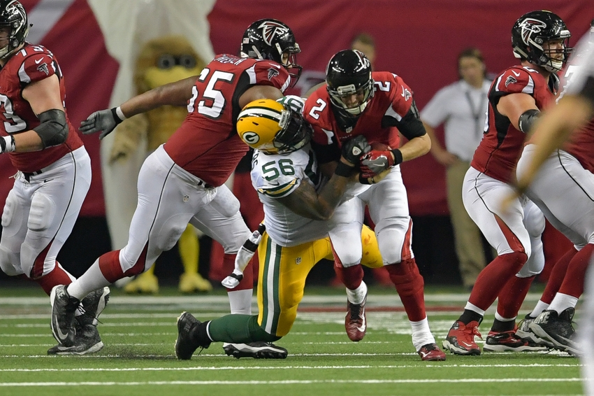 Green Bay Packers outside linebacker Julius Peppers sacks Atlanta Falcons quarterback Matt Ryan (2) during the second half at the Georgia Dome. The Falcons defeated the Packers 33-32. Dale Zanine-USA TODAY Sports