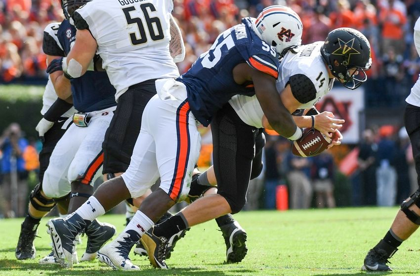 Auburn Tigers defensive lineman Carl Lawson (55) sacks Vanderbilt Commodores quarterback Kyle Shurmur (14) during the fourth quarter at Jordan Hare Stadium. Auburn won 23-16. Shanna Lockwood-USA TODAY Sports