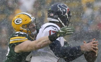 Dec 4, 2016; Green Bay, WI, USA; Green Bay Packers inside linebacker Jake Ryan (47) forces Houston Texans quarterback Brock Osweiler (17) into throwing a passing for a nine yard loss during the fourth quarter at Lambeau Field. Mandatory Credit: Mark Hoffman/Milwaukee Journal Sentinel via USA TODAY Sports
