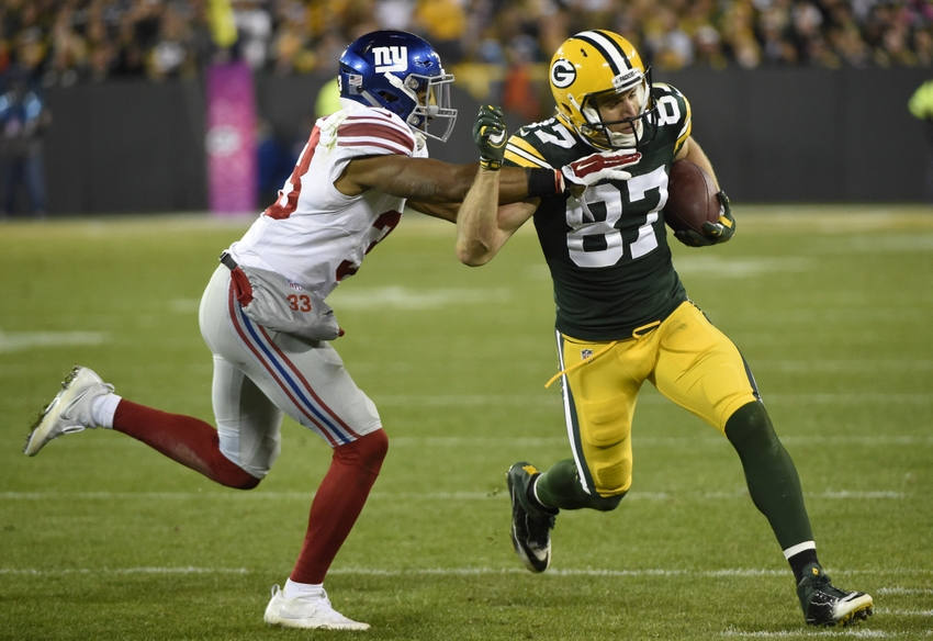 Green Bay Packers wide receiver Jordy Nelson tries to break a tackle by New York Giants safety Andrew Adams after catching a pass in the fourth quarter at Lambeau Field. Benny Sieu-USA TODAY Sports