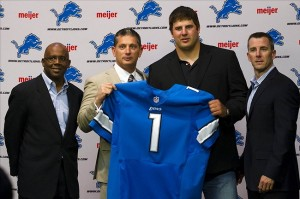 April 27, 2012; Allen Park, MI, USA; Detroit Lions first round draft pick Riley Reiff is introduced along with general manager Martin Mayhewat (left) , head coach Jim Schwartz (second from left) and president Tom Lewand (right) at Detroit Lions training facility. Mandatory Credit: Rick Osentoski-US PRESSWIRE