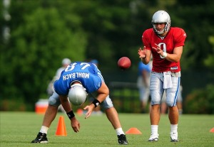 August 4, 2009; Allen Park, MI, USA; Detroit Lions quarterback Matthew Stafford (9) takes a snap from center Don Muhlbach (48) during training camp at the Lions practice facility. Mandatory Credit: Andrew Weber-US PRESSWIRE