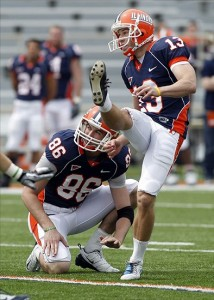 April 23, 2011; Champaign, IL, USA; Illinois Fighting Illini holder Tim Russell (86) and kicker Derek Dimke (13) watch Dimke