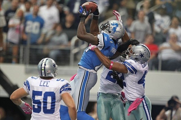 Oct 2, 2011; Arlington, TX, USA; Detroit Lions receiver Calvin Johnson (81) catches a touchdown pass in the fourth quarter against Dallas Cowboys safety Barry Church (42)and linebacker Sean Lee (50) at Cowboys Stadium. The Lions beat the Cowboys 34-30. Mandatory Credit: Matthew Emmons-US PRESSWIRE