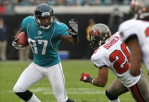 December 11, 2011; Jacksonville FL, USA; Jacksonville Jaguars wide receiver Jarett Dillard (87) stiff arms Tampa Bay Buccaneers cornerback Ronde Barber (20) during the first half at Jacksonville EverBank Field. Mandatory Credit: Kim Klement-US PRESSWIRE