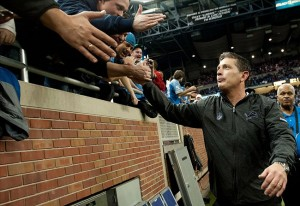 Dec 24, 2011; Detroit, MI, USA; Detroit Lions head coach Jim Schwartz high fives fans after the game against the San Diego Chargers at Ford Field. Detroit won 38-10. Mandatory Credit: Tim Fuller-US PRESSWIRE