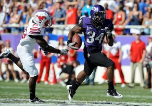 Oct 1, 2011; Fort Worth, TX, USA; TCU Horned Frogs running back Ed Wesley (34) breaks away from Southern Methodist Mustangs defensive back Chris Banjo (23) during their game at Amon G. Carter Stadium. The Mustangs defeated the Frogs 40-33 in overtime. Mandatory Credit: Jerome Miron-US PRESSWIRE