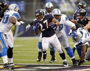 December 13, 2009; Baltimore, MD, USA; Baltimore Ravens running back Ray Rice (27) runs past Detroit Lions defensive end Cliff Avril (92) and defensive tackle Sammie Lee Hill (79) in the second quarter at M