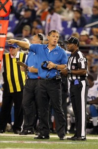 August 17, 2012; Baltimore, MD, USA; Detroit Lions head coach Jim Schwartz talks with line judge Derrick Smith (104) during their preseason game against the Baltimore Ravens at M