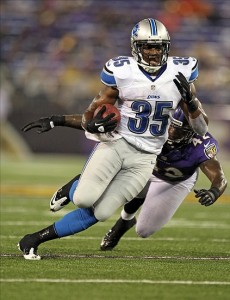 August 17, 2012; Baltimore, MD, USA; Detroit Lions running back Joique Bell (35) runs past Baltimore Ravens safety Amari Spievey (42) at M
