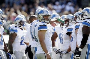 August 25, 2012; Oakland, CA, USA; Detroit Lions quarterback Matthew Stafford (9) stands in the huddle during a timeout against the Oakland Raiders in the first quarter at O.co Coliseum. Mandatory Credit: Cary Edmondson-US PRESSWIRE