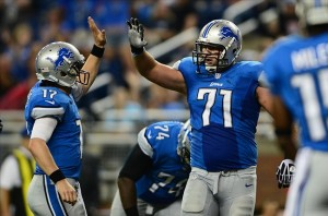 Aug 30, 2012; Detroit, MN, USA; Detroit Lions quarterback Kellen Moore (17) celebrates with tackle Riley Reiff (71) after scoring a touchdown in the fourth quarter against the Buffalo Bills in a preseason game at Ford Field. Mandatory Credit: Andrew Weber-US Presswire