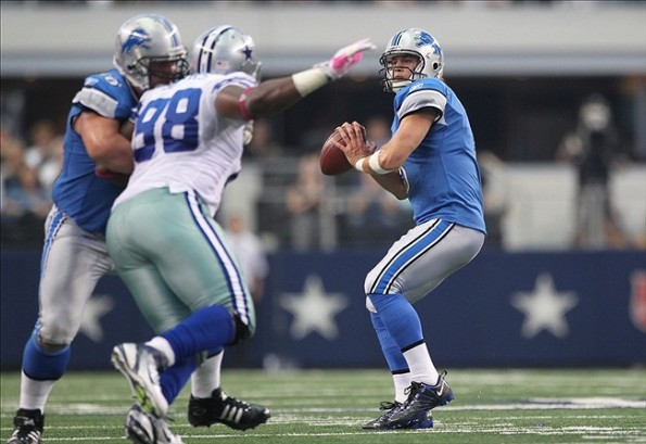 Oct 2, 2011; Arlington, TX, USA; Detroit Lions quarterback Matthew Stafford (9) throws in the pocket in the fourth quarter against the Dallas Cowboys at Cowboys Stadium. The Lions beat the Cowboys 34-30. Mandatory Credit: Matthew Emmons-US PRESSWIRE