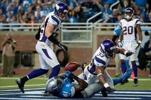 Sep 30, 2012; Detroit, MI, USA; Detroit Lions wide receiver Calvin Johnson (81) collides with Minnesota Vikings safety Jamarca Sanford (33) and is unable to complete the pass during the second quarter at Ford Field. Mandatory Credit: Tim Fuller-US PRESSWIRE