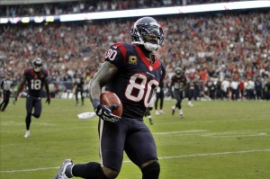Nov 18, 2012; Houston, TX, USA; Houston Texans wide receiver Andre Johnson (80) scores a game winning touchdown against the Jacksonville Jaguars in overtime at Reliant Stadium. The Texans defeated the Jaguars 43-37. Mandatory Credit: Brett Davis-US PRESSWIRE