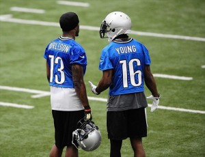 May 29, 2012; Allen Park, MI, USA; Detroit Lions wide receivers Nate Burleson (13) and Titus Young (16) during organized team activities at Lions training facility. Mandatory Credit: Andrew Weber-USA TODAY Sports