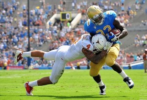 September 17, 2011; Pasadena, CA, USA; UCLA Bruins running back Johnathan Franklin (23) is brought down by Texas Longhorns safety Kenny Vaccaro (4) during the first half at the Rose Bowl. Mandatory Credit: Gary A. Vasquez-USA TODAY Sports