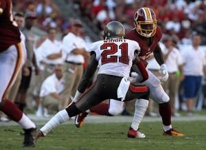 September 30, 2012; Tampa, FL, USA; Washington Redskins tight end Fred Davis (83) runs with the ball as Tampa Bay Buccaneers cornerback Eric Wright (21) defends during the first half at Raymond James Stadium. Mandatory Credit: Kim Klement-USA TODAY Sports