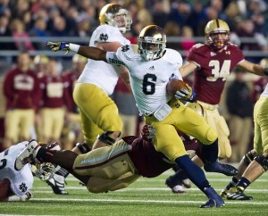 Nov. 10, 2012; Boston, MA, USA; Notre Dame Fighting Irish running back Theo Riddick (6) carries the ball as Boston College Eagles defensive tackle Bryan Murray (93) attempts to tackle in the third quarter at Alumni Stadium. Notre Dame won 21-6. Mandatory Credit: Matt Cashore-USA TODAY Sports
