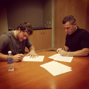 Matthew Stafford signs his contract extension with the Detroit Lions. Photo via @DetroitLionsNFL twitter account.