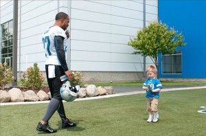 Glover Quin talks to a young fan before training camp. Tim Fuller-USA TODAY Sports