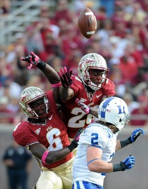 Oct 27, 2012; Tallahassee, Florida, USA; Florida State Seminoles defensive backs Lamarcus Joyner (20) and Nick Waisome (6) defend a pass intended for Duke Blue Devils wide receiver Conner Vernon (2) during the first half of the game at Doak Campbell Stadium. Mandatory Credit: Melina Vastola-USA TODAY Sports