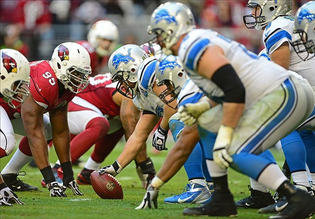 Dec. 16, 2012; Glendale, AZ, USA: Detroit Lions center Dominic Raiola (51) prepares to snap the ball against the Arizona Cardinals at University of Phoenix Stadium. The Cardinals defeated the Lions 38-10. Mandatory Credit: Mark J. Rebilas-USA TODAY Sports