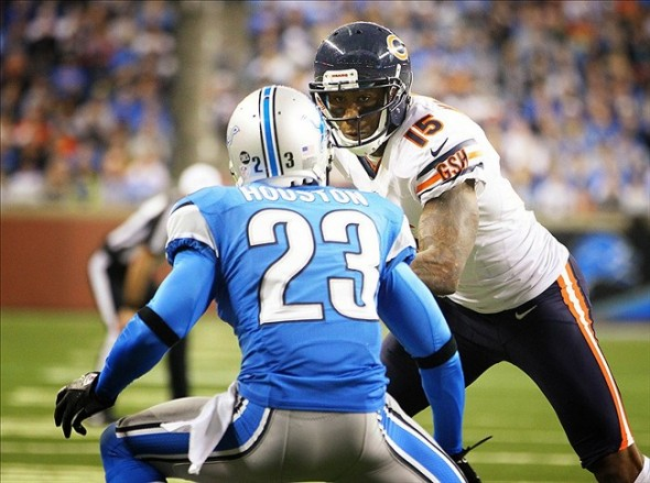 Dec 30, 2012; Detroit, MI, USA; Chicago Bears wide receiver Brandon Marshall (15) runs with the ball after a catch against Detroit Lions cornerback Chris Houston (23) during 2nd Half of a game at Ford Field. Bear won 26-24. Mandatory Credit: Mike Carter-USA TODAY Sports