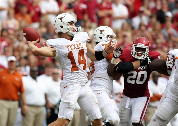 Oct 13, 2012; Dallas, TX, USA; Texas Longhorns quarterback David Ash (14) throws a pass in the third quarter against the Oklahoma Sooners during the red river rivalry at the Cotton Bowl. Mandatory Credit: Tim Heitman-USA TODAY Sports
