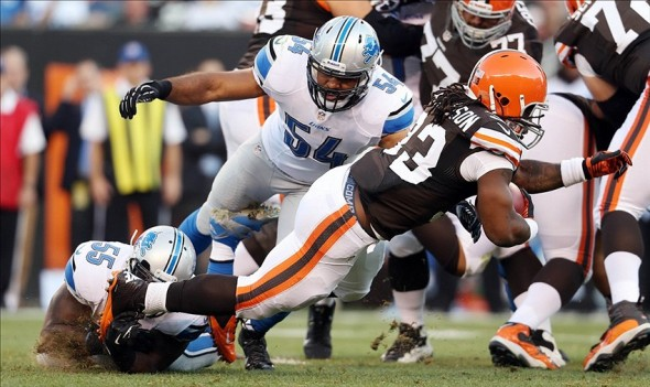 Aug 15, 2013; Cleveland, OH, USA; Detroit Lions middle linebacker Stephen Tulloch (55) and outside linebacker DeAndre Levy (54) against Cleveland Browns running back Trent Richardson (33) at FirstEnergy Field. Mandatory Credit: Ron Schwane-USA TODAY Sports
