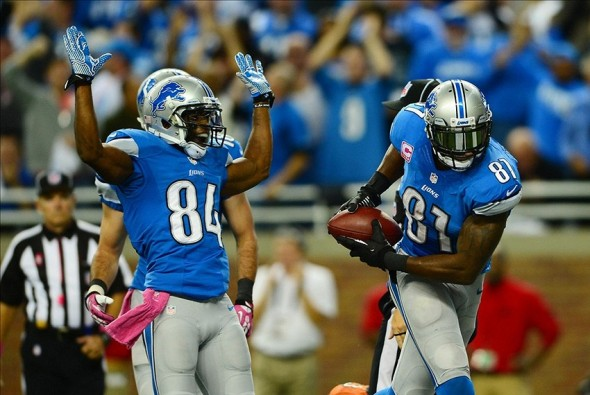 Oct 20, 2013; Detroit, MI, USA; Detroit Lions wide receiver Calvin Johnson (81) celebrates with wide receiver Ryan Broyles (84) after catching a pass for a touchdown during the fourth quarter against the Cincinnati Bengals at Ford Field. Mandatory Credit: Andrew Weber-USA TODAY Sports