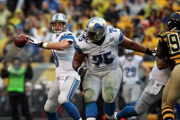 Nov 17, 2013; Pittsburgh, PA, USA; Detroit Lions quarterback Matt Stafford (9) throws a pass under protection by guard Larry Warford (75) during the first quarter at Heinz Field. Mandatory Credit: Jason Bridge-USA TODAY Sports