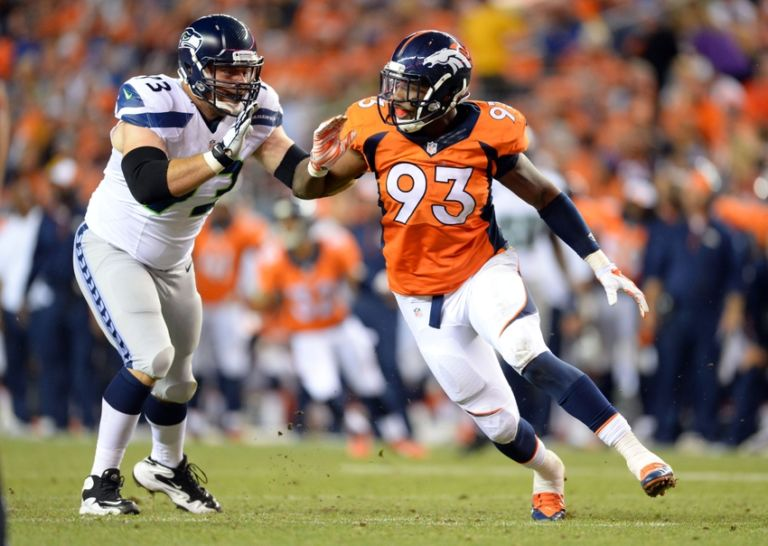 Quanterus-smith-eric-winston-nfl-preseason-seattle-seahawks-denver-broncos-768x546