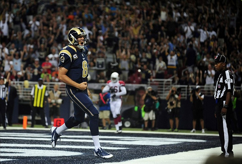 Sep 8, 2013; St. Louis, MO, USA; St. Louis Rams quarterback Sam Bradford (8) celebrates after running in to the end zone for a two point conversion against the Arizona Cardinals during the second half at Edward Jones Dome. St. Louis defeated Arizona 27-24. Mandatory Credit: Jeff Curry-USA TODAY Sports