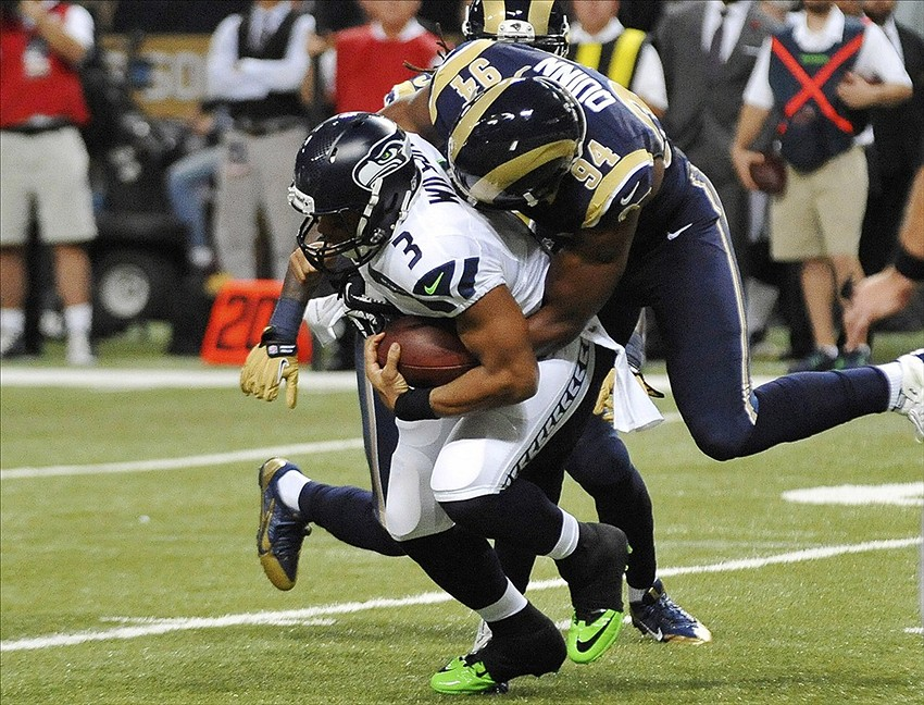 Oct 28, 2013; St. Louis, MO, USA; St. Louis Rams defensive end Robert Quinn (94) sacks Seattle Seahawks quarterback Russell Wilson (3) during the first half at Edward Jones Dome. Mandatory Credit: Jasen Vinlove-USA TODAY Sports
