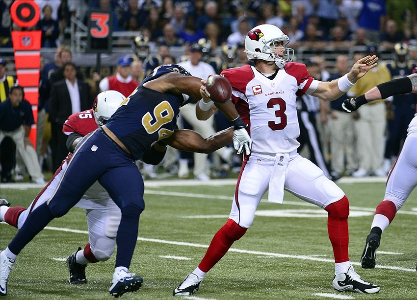 Sep 8, 2013; St. Louis, MO, USA; St. Louis Rams defensive end Robert Quinn (94) knocks the ball away from Arizona Cardinals quarterback Carson Palmer (3) during the second half at Edward Jones Dome. The Rams recovered the ball and went on to defeat the Cardinals 27-24. Mandatory Credit: Scott Rovak-USA TODAY Sports