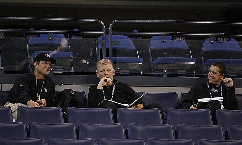 Feb 25, 2012; Indianapolis, IN, USA; From left San Francisico 49ers coach Jim Harbaugh , Baltimore Ravens coaches Cam Cameron and John Harbaugh scout and watch the the workouts during the NFL Combine at Lucas Oil Stadium. Mandatory Credit: Brian Spurlock-USA TODAY Sports