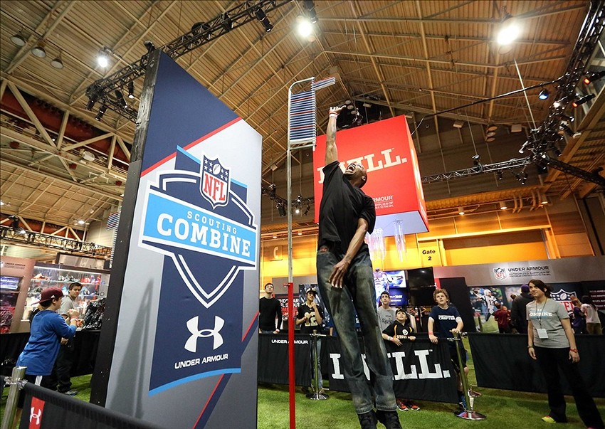 Feb 02, 2013; New Orleans, LA USA; Rashad Thornton Sr., of New Orleans, jumps into the air at the Under Armour scouting combine area inside the NFL Experience, pro football
