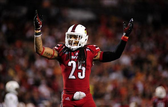 Dec 28, 2013; Orlando, FL, USA; Louisville Cardinals safety Calvin Pryor (25) waves his arms to the crowd in the fourth quarter as theCardinals beat the Miami Hurricanes 36-9 to win the Russell Athletic Bowl at Florida Citrus Bowl Stadium. Mandatory Credit: David Manning-USA TODAY Sports