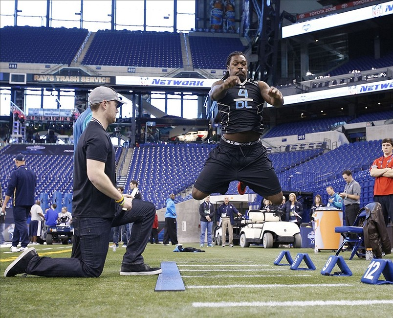 Feb 24, 2014; Indianapolis, IN, USA; South Carolina Gamecocks defensive end Jadeveon Clowney jumps the long jump during the 2014 NFL Combine at Lucas Oil Stadium. Mandatory Credit: Brian Spurlock-USA TODAY Sports