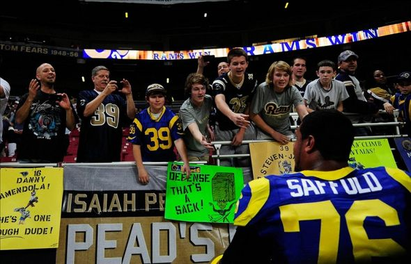 December 2, 2012; St. Louis, MO, USA; St. Louis Rams tackle Rodger Saffold (76) talks with fans after defeating the San Francisco 49ers in overtime at the Edward Jones Dome. St. Louis defeated San Francisco 16-13 in overtime. Mandatory Credit: Jeff Curry-USA TODAY Sports