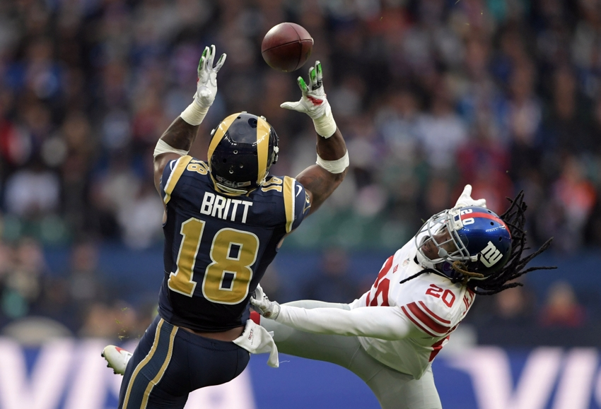 Oct 23, 2016; London, United Kingdom; Los Angeles Rams receiver Kenny Britt (18) is defended by New York Giants cornerback Janoris Jenkins (20) during game 16 of the NFL International Series at Twickenham Statdium. The Giants defeated the Rams 17-10. Mandatory Credit: Kirby Lee-USA TODAY Sports
