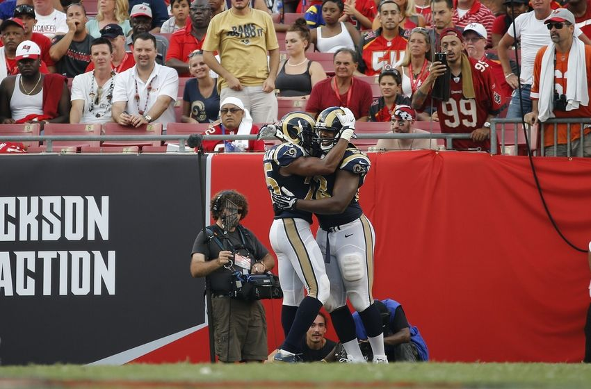 Sep 25, 2016; Tampa, FL, USA; Los Angeles Rams defensive tackle Ethan Westbrooks (93) is congratulated by strong safety T.J. McDonald (25) after he scored a touchdown against the Tampa Bay Buccaneers during the second half at Raymond James Stadium. Mandatory Credit: Kim Klement-USA TODAY Sports