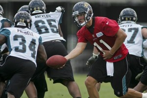 June 12, 2012; Jacksonville FL, USA; Jacksonville Jaguars quarterback Blaine Gabbert (11) hands off to running back Jalen Parmele (34) during minicamp at Florida Blue Health