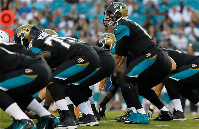Aug 9, 2013; Jacksonville, FL, USA; Jacksonville Jaguars quarterback Blaine Gabbert (11) gets ready at the line of scrimmage during the first quarter against the Miami Dolphins at EverBank Field. Mandatory Credit: Kim Klement-USA TODAY Sports