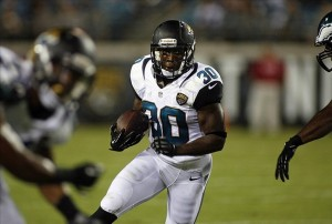 Aug 24, 2013; Jacksonville, FL, USA; Jacksonville Jaguars running back Jordan Todman (30) runs for a first down during the second quarter of their game against the Philadelphia Eagles at EverBank Field. Mandatory Credit: Phil Sears-USA TODAY Sports